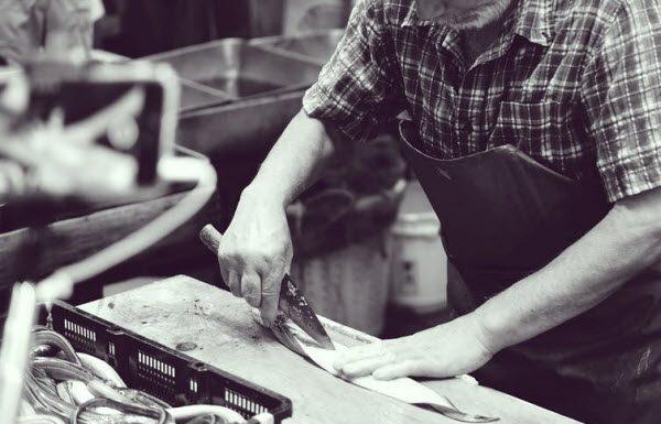 Man cutting a raw fish
