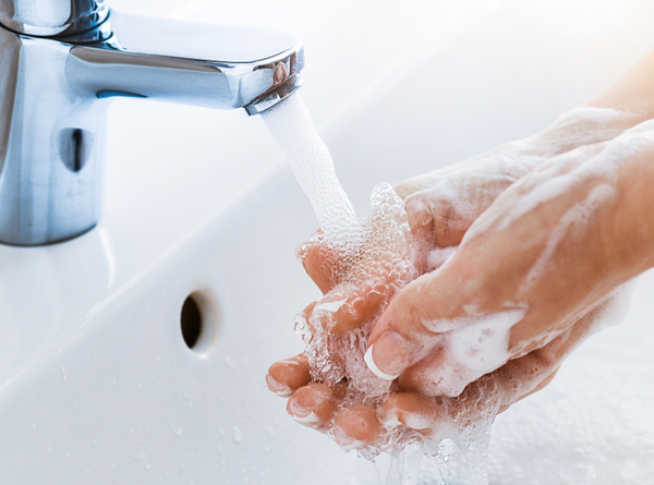 DG - Woman use soap and washing hands under the water tap