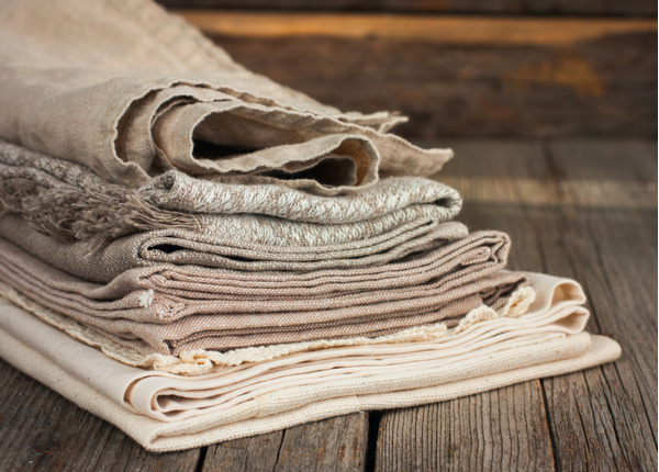 Linen tea towels beige on a wooden table