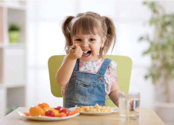Infant eating healthy food