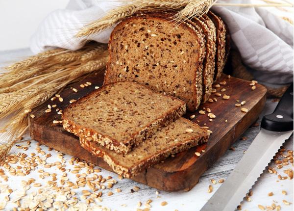 Sliced rye bread on cutting board